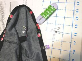 Thread and safety pins go hand in hand when putting elastic in a sleeve.