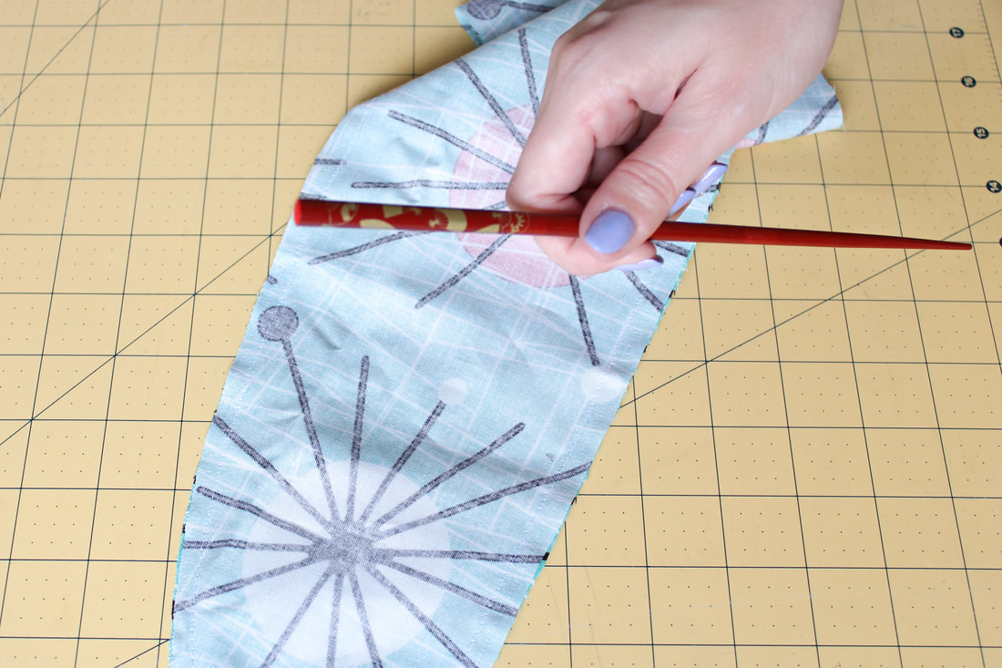Using a chopstick as a sewing turning tool