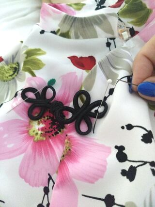 Hand sewing frog closures on to the 8244 Simplicity dress