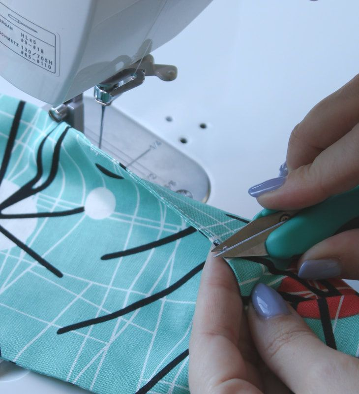 Using sewing snips for loose threads. Easy rockabilly sewing pattern